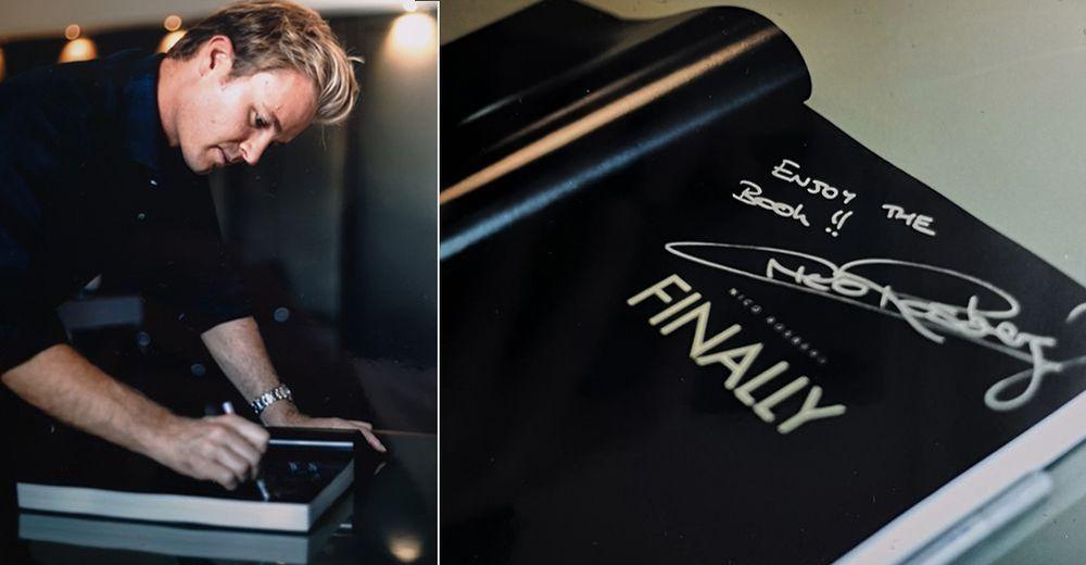 Nico Rosberg signiert seinen Bildband